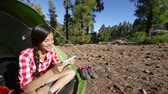 mixed race : Tablet pc - camping girl taking selfie photo selfportrait at campsite in tent in forest. Beautiful young smiling happy mixed race Asian Caucasian woman model in outdoor activity