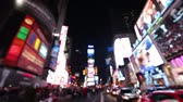New York City, Times Square, Manhattan background out of focus with blurry unfocused city lights and billboards. City at night with cars and pedestrians people walking.
