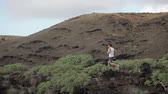 perda de peso : Runner. Trail man running in nature landscape doing cross country run. Fit male runner training jogging outdoors in beautiful mountain nature landscape on Tenerife, Canary Islands, Spain.