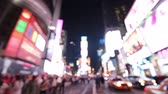 nový : Times Square, New York City, Manhattan background out of focus with blurry unfocused city lights and billboards. City at night with cars and pedestrians people walking.