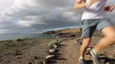 мужской : Sport running man in cross country trail run. Fit male runner exercise training beautiful ocean nature landscape on Tenerife, Canary Islands, Spain.