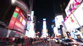 nový : New York City, Times Square, Manhattan background out of focus with blurry unfocused city lights and billboards. City at night with cars and pedestrians people walking.