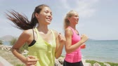 женщина : Running women runners training outdoors. Close up portrait of happy woman runner jogging outside with friends on beach. RED EPIC footage in SLOW MOTION.