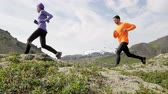 pomalý : Cross country runners in trail running sport. People  woman and man runners training jogging outdoors in beautiful mountain nature landscape on Snaefellsnes  Iceland. RED EPIC SLOW MOTION at 90 FPS. Dostupné videozáznamy