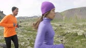 trénink : Running sport. Runners on cross country trail outdoors working out for marathon. Fit young fitness model man and asian woman training outside in nature on Snaefellsnes  Iceland. RED EPIC  120 FPS.