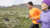 dışarı : Running people trail runners in cross country run. Woman and man runners training jogging outdoors in beautiful mountain nature landscape on Snaefellsnes  Iceland. RED EPIC  120 FPS SLOW MOTION.