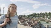 switzerland : Woman walking in Bern  Switzerland. Woman traveler visiting tourists attractions and landmarks in Berne. Mixed race Asian Caucasian female model on the Nydegg Bridge by the Aare river. 60 FPS RED EPIC Stock Footage