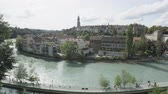 switzerland : Bern  Switzerland - Aare river and city view. Pan of cityscape showing B�rengraben tourist attraction city landmarks in summer.
