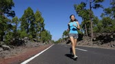 floresta : Running woman jogging exercising outdoor. Female runner on training run outside on mountain forest road. Asian fitness girl on jog in nature.