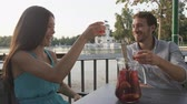 Мадрид : Couple drinking sangria in cafe outdoors in Madrid, Spain in El Retiro city park. Romantic couple, woman and man lifestyle in Buen Retiro Park, Parque el Retiro in Madrid, Spain, Europe. Стоковые видеозаписи