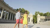 rei : People walking in Madrid in El Retrio park. Couple holding hands on romantic walk by Madrid tourist attraction, the Monument to King Alfonso XII of Spain, Monumento a Alfonso XII. RED EPIC.