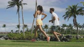 два человека : Couple in sportswear running jogging together in park. Runners in active summer lifestyle, two young adults joggers cardio training in city park or living healthy lifestyle outdoors. SLOW MOTION.