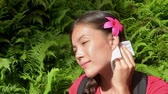 анти : Mosquito repellent. Woman using paper wipes with insect repellent on skin outdoor in nature forest. Girl applying repeller to face.