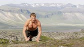 modelka : Pushups fitness man doing push-ups outside in amazing nature landscape on Iceland. Fit male sport model training crossfit outdoors doing clap push-up. Caucasian athlete in his 20s. RED EPIC 90 FPS.
