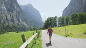 schweiz : Hiking woman walking in Switzerland alps. Woman hiker tourist on hike in Swiss alpine nature landscape in Lauterbrunnen valley in Bernese Oberland, Schweiz, Europe. RED EPIC SLOW MOTION. Stock Footage