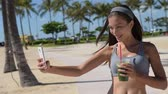 mulheres : Fit Young Woman with Healthy Green Detox Vegetable Drink Taking Selfie Self Portrait Photograph Picture at the Beach after Fitness Workout. Sport and Healthy Eating Concept.