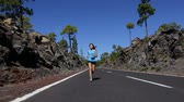 workout : Full Length Capture of Healthy Young Woman Running on Road in Forest Nature. Female Fitness Runner Girl in Outdoor Jogging Workout.
