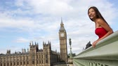 gezi : London - happy woman by Big Ben in England. Beautiful tourist girl sightseeing travel on Westminster Bridge, London, England, United Kingdom. Multiracial Asian Caucasian female model travelling.