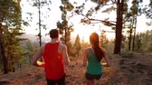 два человека : Running Health and fitness. Runners on run training during fitness workout outside in mountain forest at sunset. People jogging together living healthy active lifestyle outside. Woman and man. 2 clips