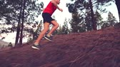 джунгли : Fitness running man jogging in forest. Low angle view of fit young man running in forest. Male runner is in sportswear. He is representing his healthy lifestyle.