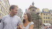 caminhada : Happy couple in love walking in Gamla Stan, Stockholm city visiting Sweden. Young adults tourists on travel or Swedish urban people in summer walking on a date. Stock Footage