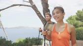 два человека : Healthy lifestyle couple hiking in forest nature on Mallorca, Europe. Young people walking in beautiful landscape on the coast of Mallorca, Balearic Islands, Spain. European summer destination.