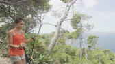 espanhol : Hiking people walking in nature on Mallorca, mediterranean Europe. Young adult couple walking in beautiful landscape on the coast of Mallorca, Balearic Islands, Spain. European summer destination. Stock Footage