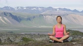 rozjímání : Meditation yoga woman meditating in nature. Female model relaxing in serene harmony in lotus position pose. Healthy wellness lifestyle image with multicultural young woman. Image from Iceland.