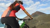 passeio : MTB mountain biking woman cycling on bike. Dedicated sporty woman riding bicycle in mountain nature landscape. Female cyclist training in recreational outdoor activity living healthy lifestyle.