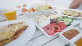 variação : Breakfast table. Delicious breakfast served on table. Variety of food served on outdoor terrace.