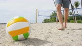 voleibol : Friends playing beach volleyball sport having active fun living healthy lifestyle. Man player picking up ball walking during volley ball after game in summer. Woman and man fitness model doing sport. Stock Footage