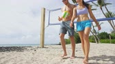 женщины : Friends talking after beach volleyball active fun living sporty active lifestyle. Portrait of people walking with volley ball after game in summer. Woman and man fitness model doing sport on beach.