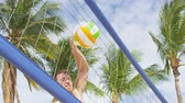 bolas : Beach volleyball sport in summer. Man spiking volley ball in hard spike jump smash. Friends playing jumping to smash. People having fun recreational game living healthy active lifestyle