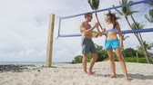 tremer : High five people in beach volleyball shaking hands after volley ball game on summer beach. Man and woman model living healthy active fitness lifestyle doing sport on beach. Stock Footage