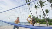 voleibol : Friends Playing Beach Volleyball On Beach. Young people having fun playing recreational game in summer.