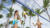 voleibol : Friends playing beach volleyball sport having fun in summer. Woman and man in recreational volley ball game in living healthy active sport lifestyle Stock Footage