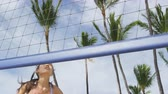 voleibol : Beach volleyball woman playing volley hitting volley ball during game on summer beach. Female model living healthy active lifestyle doing sport on beach Stock Footage