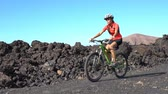 ciclista : Mountain biking MTB cyclist woman cycling on bike trail path. Female mountain biker on bike in sportswear riding bicycle enjoying healthy active lifestyle in nature, Lanzarote, Canary Islands, Spain