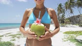 coco : Woman drinking fresh coconut water with straw on Caribbean beach fun vacation. Closeup of unrecognizable woman holding young green tropical fruit sipping for healthy snack during summer holidays. Vídeos