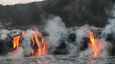 visto : Lava flowing in the ocean from volcanic lava eruption on Big Island Hawaii. Seen from lava boat tour. Lava from Kilauea volcano by Hawaii volcanoes national park, USA. Dawn, steadicam, 59.94 FPS. 2016