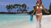 menina : Bikini woman happy having fun running on white sand beach with snorkel fins and snorkeling gear. Tropical vacation girl relaxing in summer travel destination paradise doing ocean swimming activity.