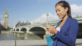 spojené království : Phone. Business woman using smartphone sms texting using app by Westminster Bridge London, England. Young businesswoman using mobile phone smiling happy in suit outdoors. Urban female professional.