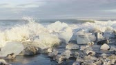 bloco : Iceland Ice beach  Jokulsarlon Iceberg beach. Breidamerkursandur beach by jokulsarlon glacial lagoon, Vatnajokull National Park, Iceland. RED EPIC, 96 FPS, SLOW MOTION. Stock Footage