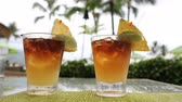 típico : Alcoholic drinks for romantic couple standing on table on vacation resort. Close up of two Mai Tai drinks on Hawaii. Typical Hawaiian drink.