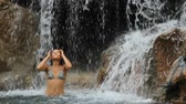 bonito : Waterfall with woman in bikini smiling happy in natural pool on travel. Sexy beautiful girl in pristine nature enjoying summer travel vacation. Stock Footage