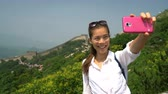 badaling : Great Wall of China. Woman tourist taking selfie photo at famous Badaling during travel holidays at Chinese tourist destination. Woman tourist taking picture using smart phone during Asia vacation.