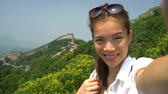 badaling : Selfie video. Girl tourist at Great Wall of China at famous Badaling during travel holidays at Chinese tourist destination.