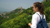 badaling : Great Wall of China. Tourist taking photo at famous Badaling during travel vacation holidays sightseeing Chinese tourist attractions. Woman tourist taking picture using smart phone in Asia. Stock Footage