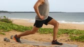 tons : Fitness man doing Pulse Lunges exercise. Male fitness model doing Lunge Pulses workout while exercising on beach working out glutes, hamstrings and quadriceps. Left leg.
