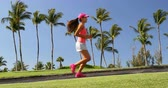 生活方式 : Woman running. Girl jogging in park living an active summer. Female runner exercising running training on sidewalk, healthy lifestyle.